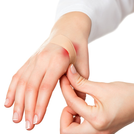 firstaid: Putting plaster on hurt red skin