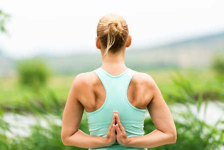 female hands: Reverse Prayer Yoga Pose