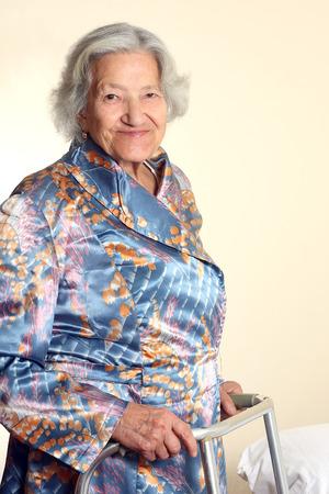 Senior woman using a walker Reklamní fotografie