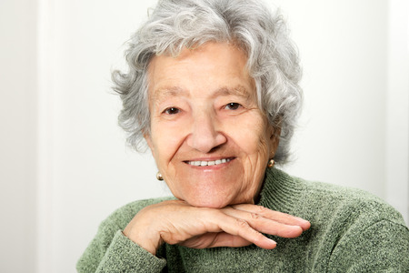 congenial: Smiling happy senior lady portrait Stock Photo