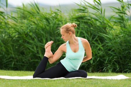 aerobic treatment: Woman making yoga one legged king pigeon pose