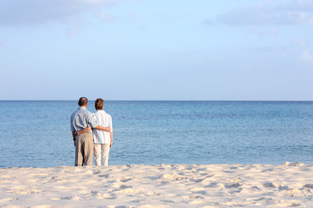 couple relaxing: Senior couple at the beach