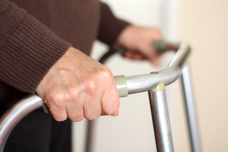 elderly: Senior using a walker