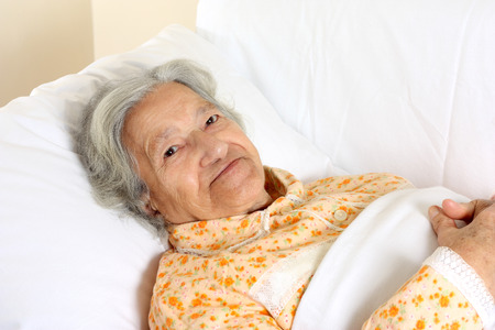 Senior woman in the hospital bed Stock fotó