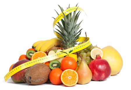 mixed fruits: Tape measure and mixed fruits Stock Photo