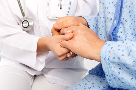 Patient hand holding