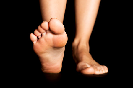 bare women: Foot isolated on black