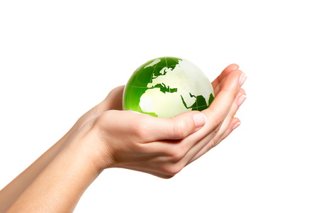 equitable: Green world in hand Stock Photo