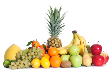 eating fruit: Group of fruits isolated Stock Photo