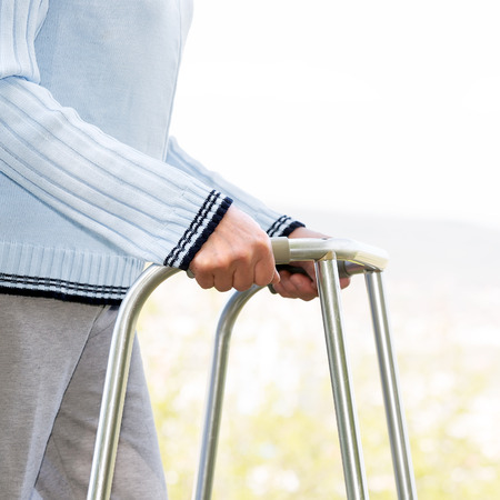 physical therapy: Senior woman using a walker Stock Photo