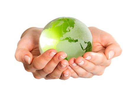 glass globe: Green glass globe in hand isolated