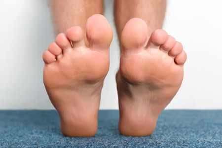 Clean male toes without any dermatological issues.