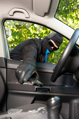 successfully: Thief successfully breaking a vehicles window.