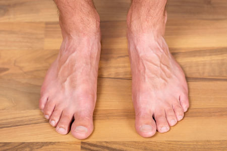 foot step: Healthy pair of male toes without fungus or other skin problems on the floor.