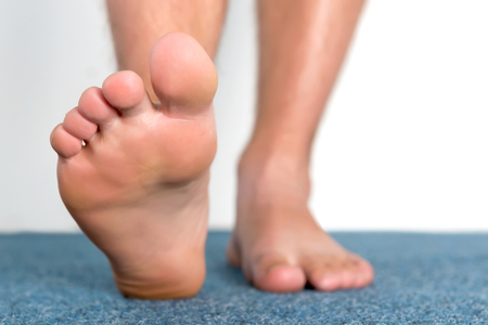foot fungus: Healthy male feet feeling comfortable at home. Stock Photo