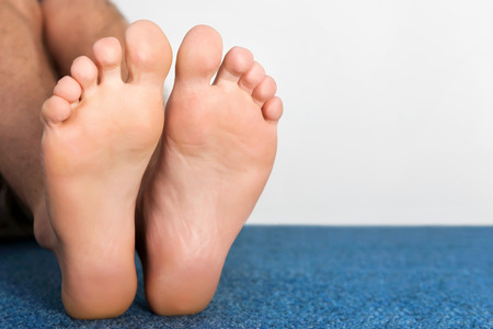 Healthy male feet feeling comfortable at home. Stockfoto
