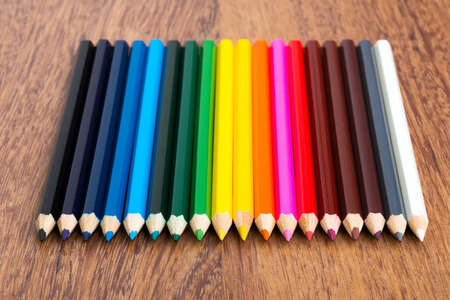 color pencils: Many different colored pencils on wood background