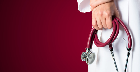 Red medical background with nurse and red stethoscope Stock Photo