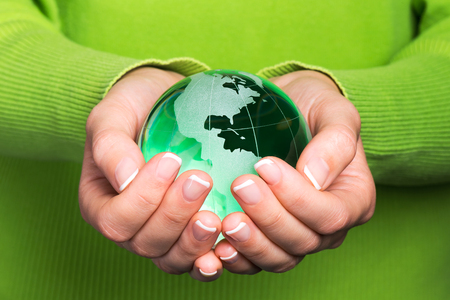 earth map: Environmental protection concept with glass globe in hand