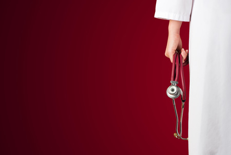 red stethoscope: Red medical background with red stethoscope