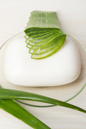 constituent: Green Aloe Vera leaf backround with soap