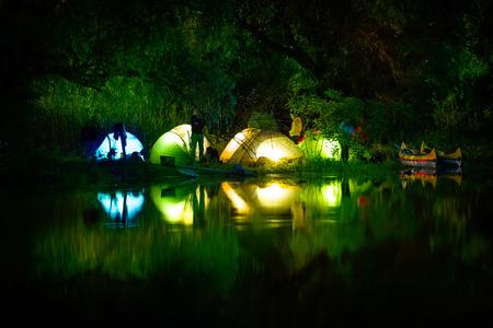 danube delta: Illuminated tent on a lake with reflexions, Danube Delta, Romania
