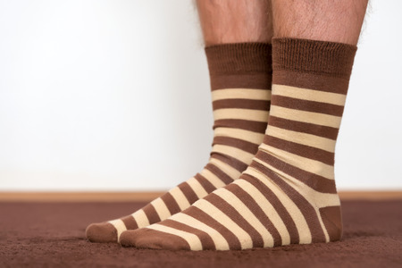 resting: Wearing comfortable striped socks at home.