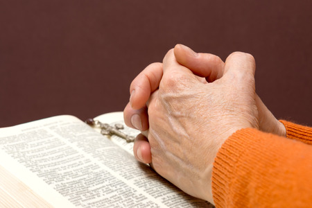 ascetic: Hand next on holy Bible