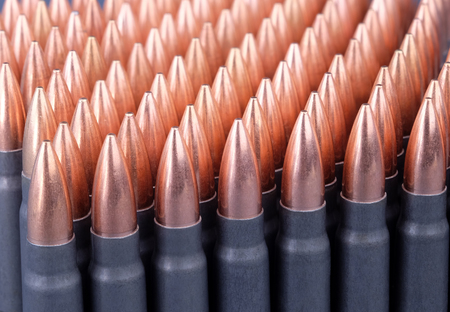 diagonally: Live ammunition for automatic weapons or rifles ranked diagonally closeup. Stock Photo