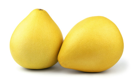 pummelo: Two ripe pear-shaped yellow pomelo fruit isolated on white background.