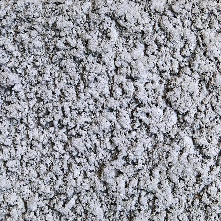 grizzle: The surface of the gray concrete chips for a background texture.