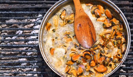purified: Purified from the shells of sea mussels simmer in a creamy sauce over an open fire outdoors.