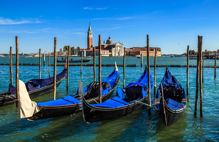 VENICE, ITALY - SEPTEMBER 26, 2018: Gondolas on the background of San Giorgio Maggiore island and Cathedral of the same name. View from the waterfront near Saint Marks square. 報道画像