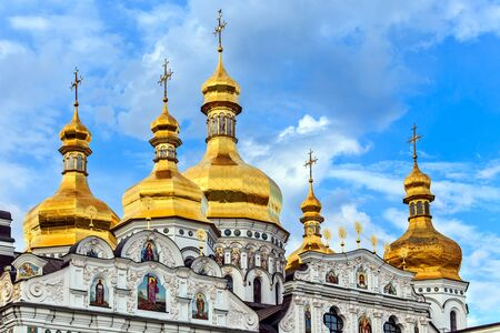 Golden cupolas with crosses of the The Cathedral of the Assumption of the blessed virgin Mary in Kiev Pechersk Lavra Orthodox monastery, Kiev, Ukraine.