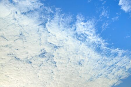 Blue sky covered with clouds. Image for backgrounds.
