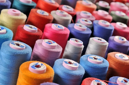 tailor shop: Colorful reels of threads background  Stock Photo