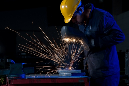 Welder uses torch to making sparks Stock Photo - 14121102