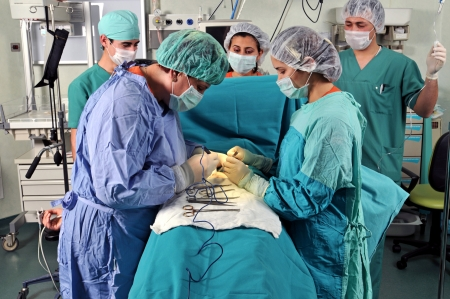 Surgeons surrounding patient on operation table