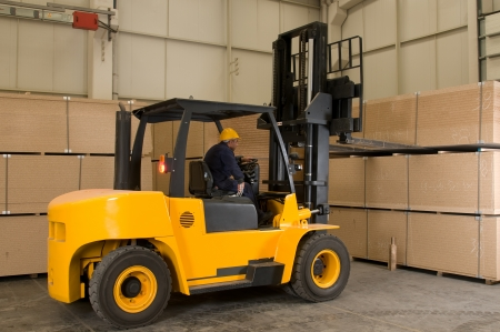Forklift operator working at factory