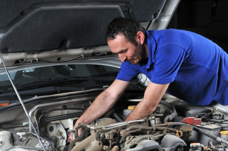 oil change: Car mechanic working on car - a series of MECHANIC related images Stock Photo