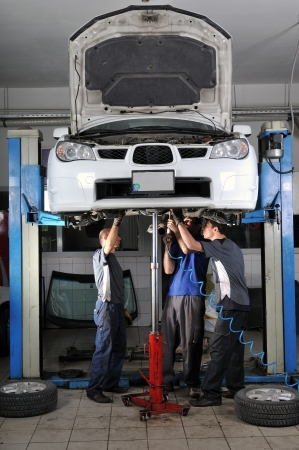 service lift: Auto mechanics working under the car - a series of MECHANIC related images.