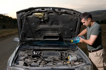 Adult man filling windshield washer reservoir Stock Photo - 14341878
