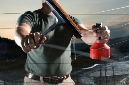 Rubber window cleaner and spray  Stock Photo