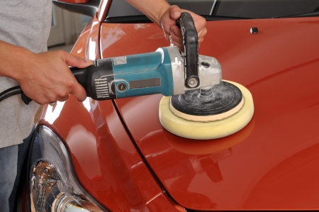 polisher: Car care with power buffer machine at service station
