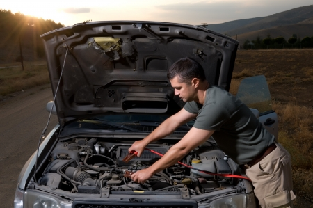 Booster cables to transfer power to dead battery