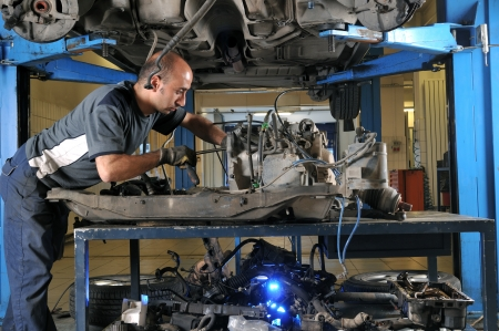 Auto mechanic working under the car - a series of MECHANIC related images Stock Photo