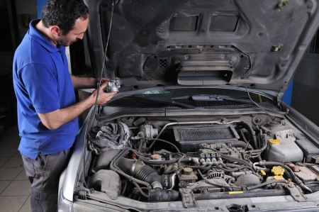 Car mechanic fixing an auto - a series of car repair images photo