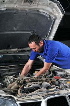 Car mechanic fixing an auto Stock Photo