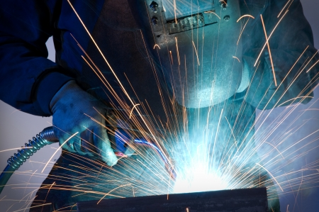 skilled labour: Worker welding steel - a series of METAL INDUSTRY images   Stock Photo
