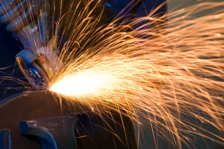 steel factory: Worker making sparks while welding steel isolated - a series of METAL INDUSTRY images Stock Photo